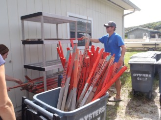 Stakes used to mark Sea Turtle nests were collected, stored in containers, wrapped up and brought indoors