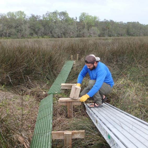 Biologist, Matt Monroe, building platform sections.
